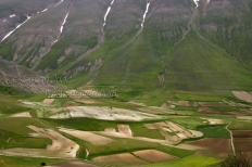 Patterns in fields and mountains near Casteluccio on the Piano Grande