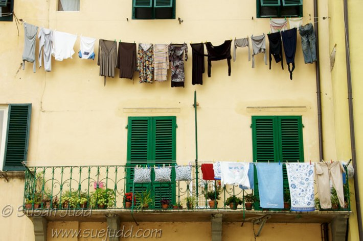 Yellow wall and washing, Lucca, Italy