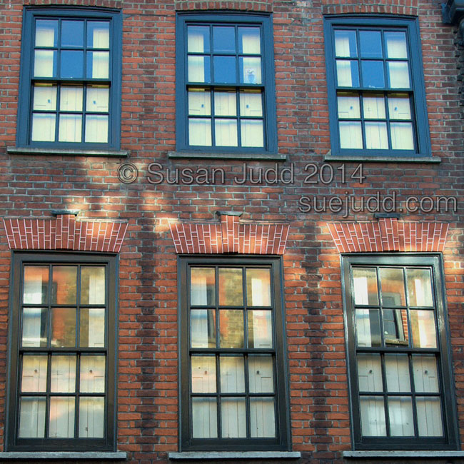 Reflections in windows of Modern Saree Centre, Spitalfields