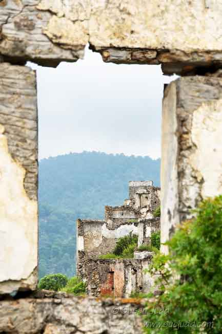 View of ruins through a ruined window, Kayakoy