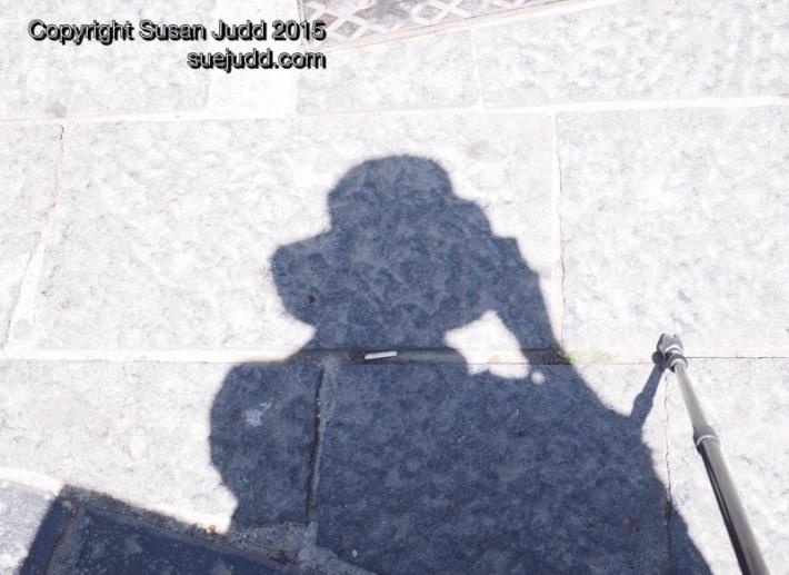 Shadow of a hat wearer