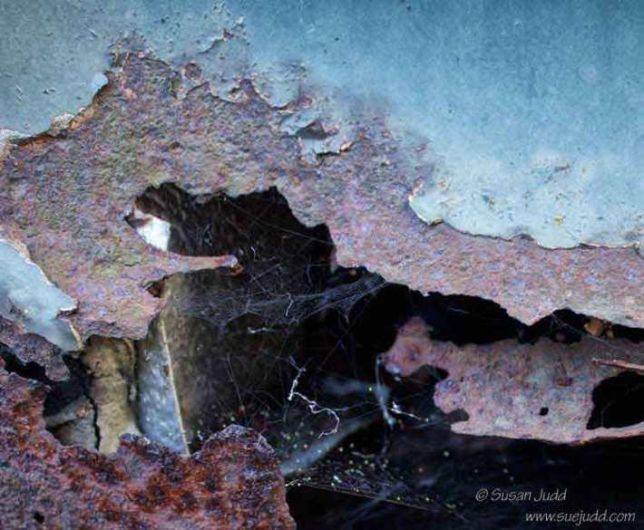 Corrosion and a small cobweb